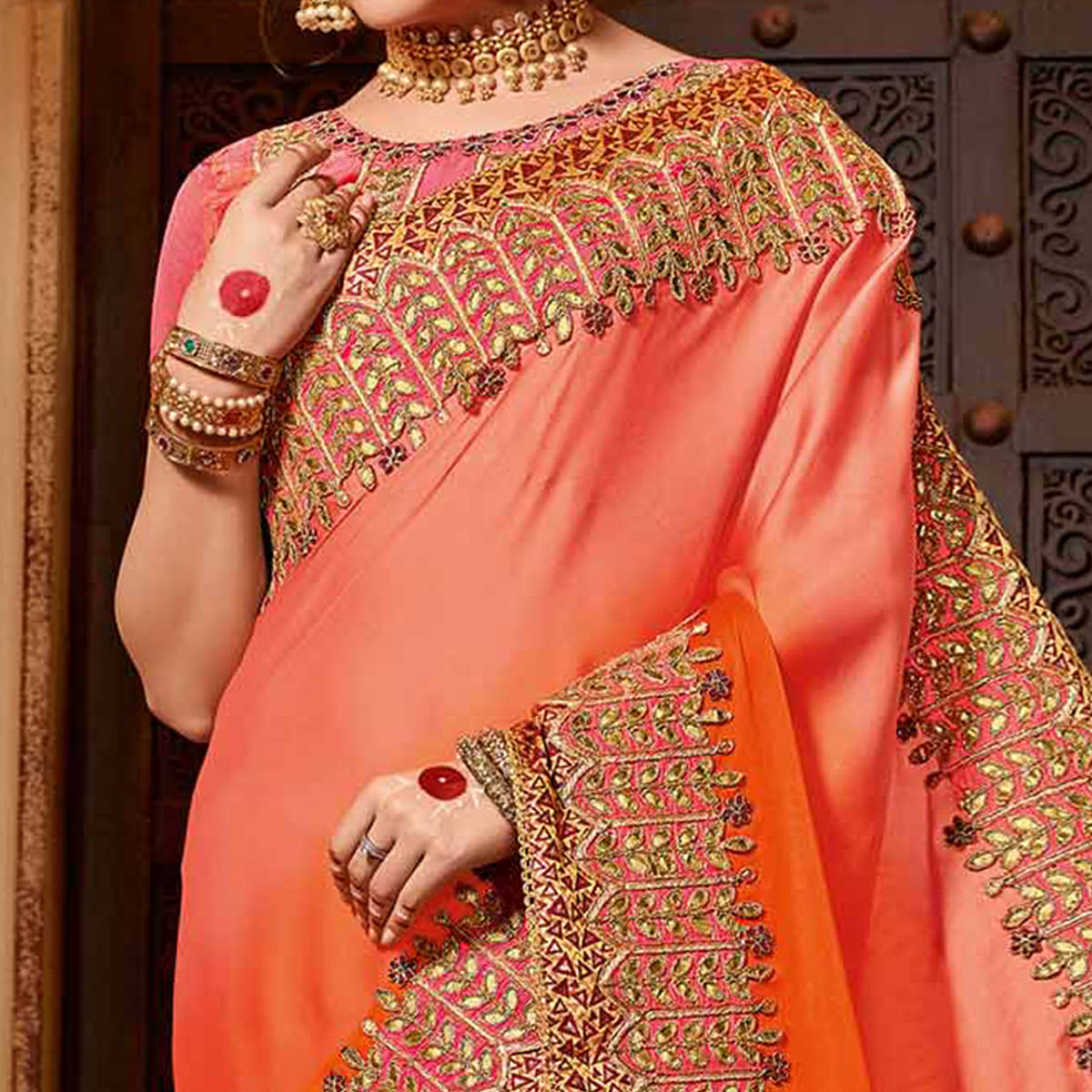 Classy Orange Colored Partywear Embroidered Georgette Saree