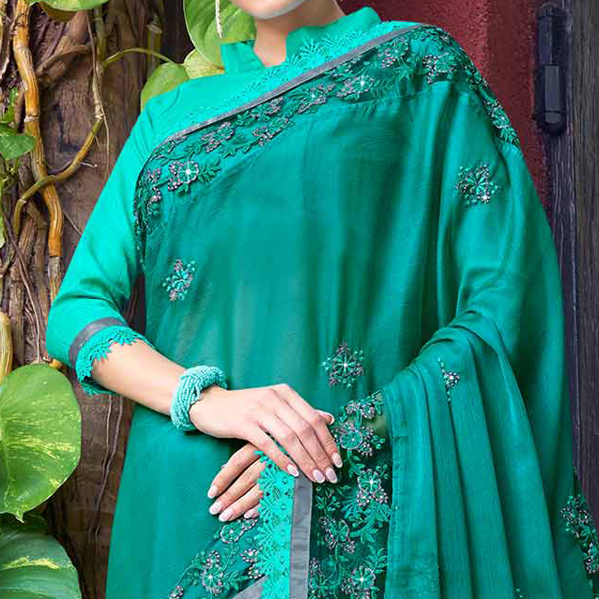 Glowing Turquoise Green Colored Partywear Embroidered Chiffon Saree