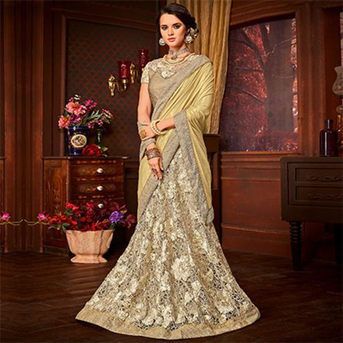 Awesome Golden Colored Designer Embroidered Partywear Half-Half Net-Jacquard Lehenga Saree