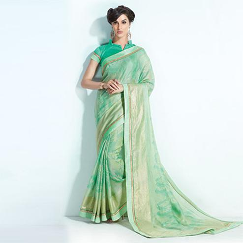 Stylish Pista Green Colored Printed Crystal Handloom Silk Saree