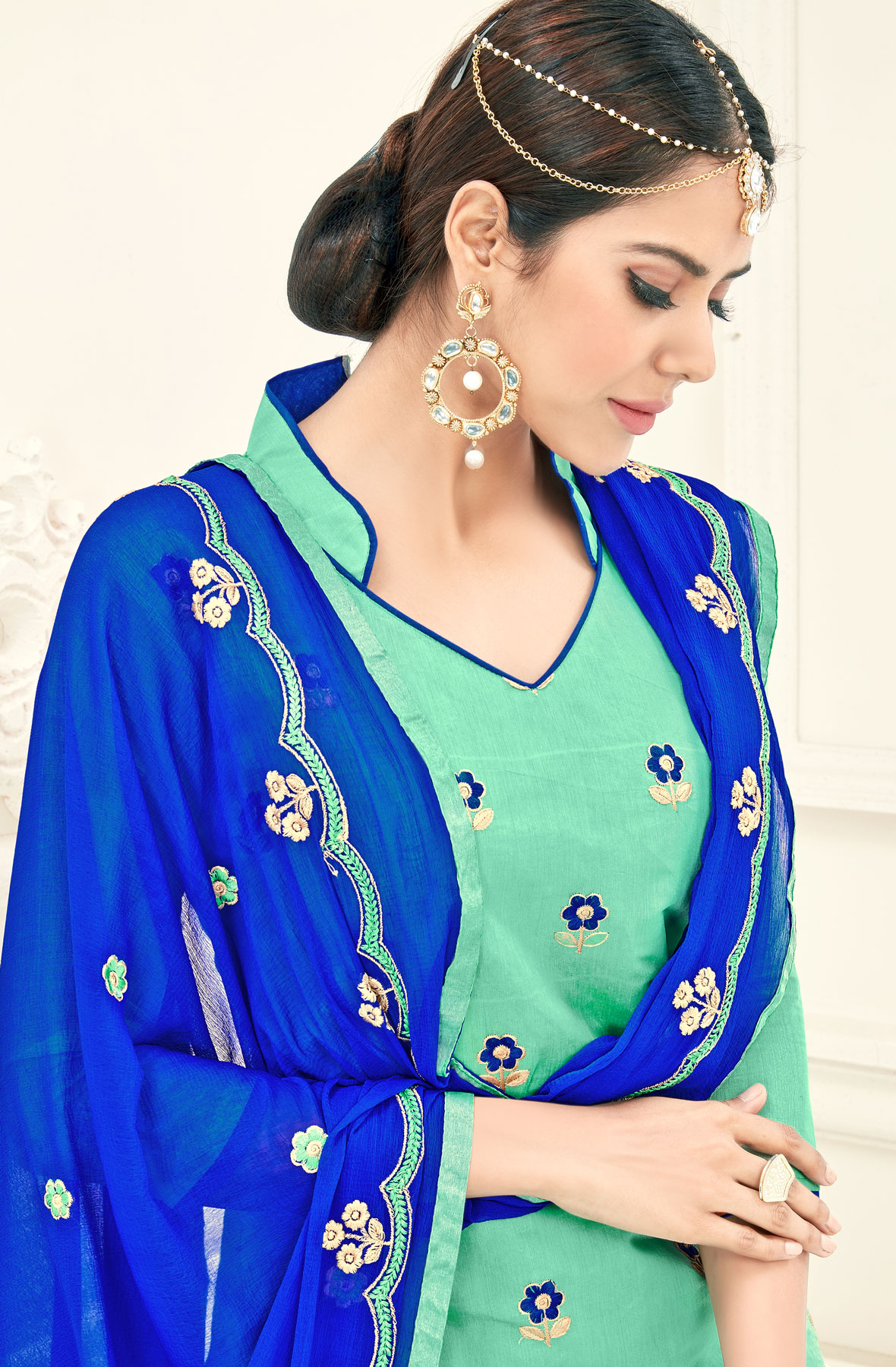 Mesmerising Aqua Green Colored Partywear Embroidered Cotton Suit