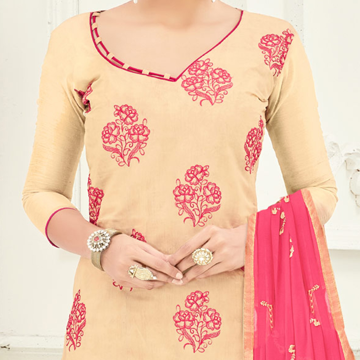 Deserving Beige Colored Partywear Embroidered Cotton Suit