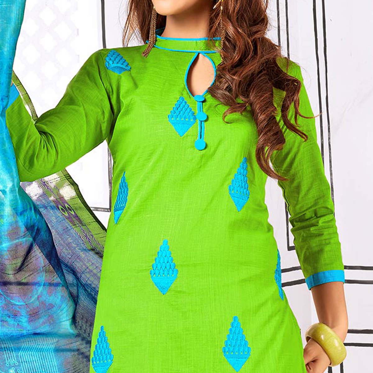 Glowing Green Colored Partywear Embroidered Cotton Suit