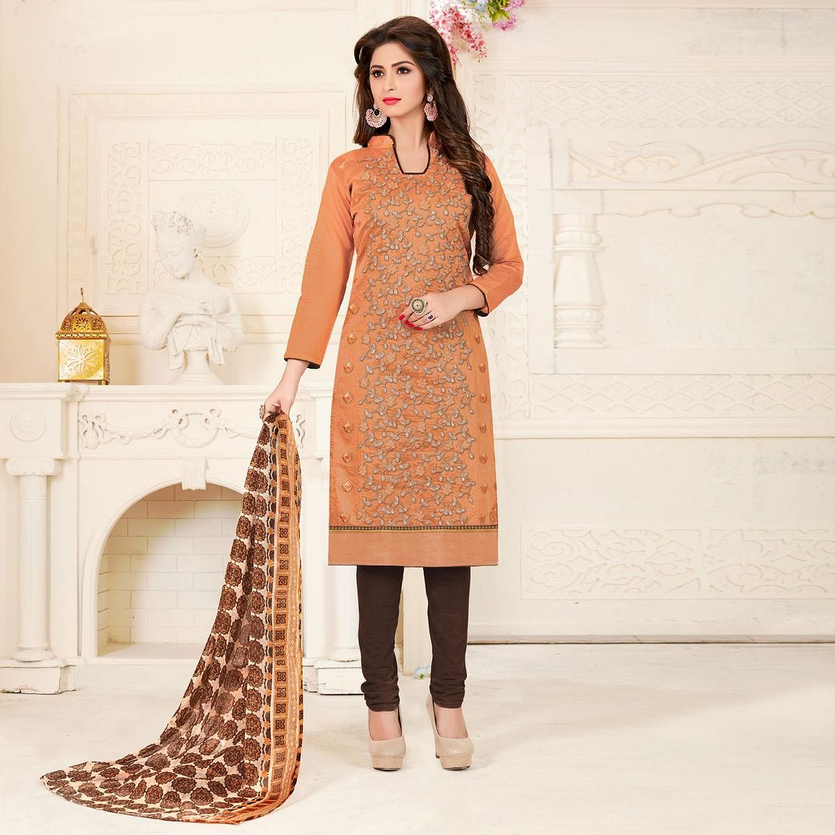 Mesmerising Light Orange Colored Partywear Embroidered Chanderi Silk Suit