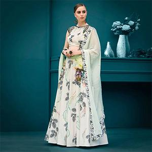 Charming Off-White Colored Designer Partywear Digital Printed Silk Lehenga Choli
