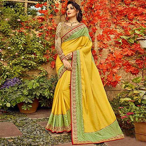 Prominent Yellow Colored Designer Partywear Slub Silk Saree