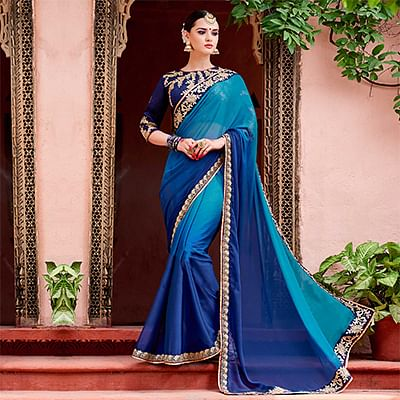 Charming Shaded Blue Colored Designer Partywear Rangoli Padding Silk Saree