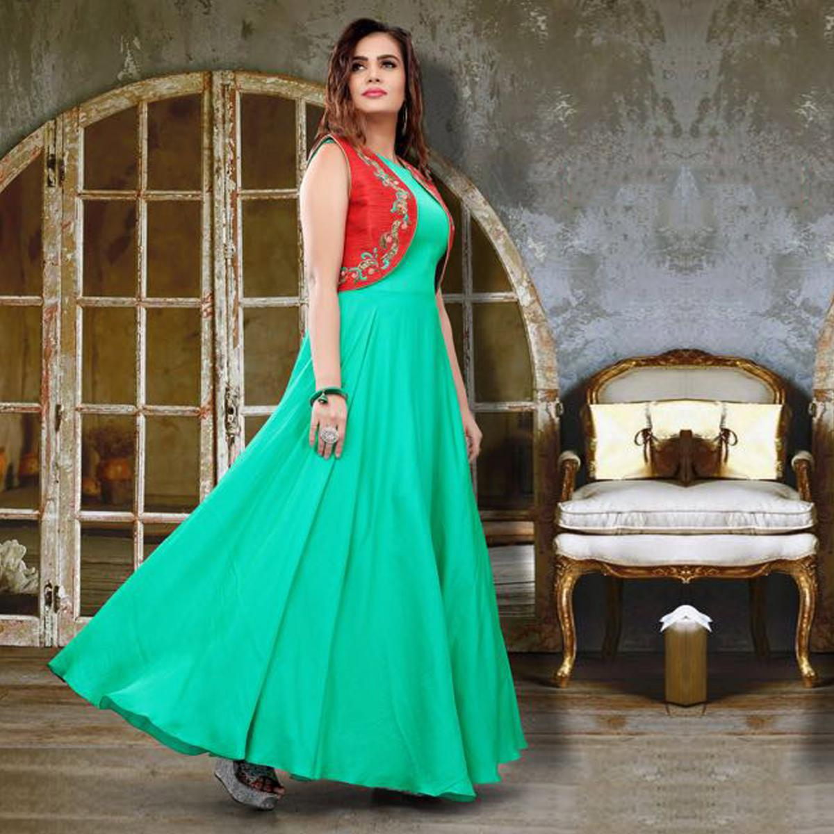 Beautiful Aqua Green Colored Partywear Embroidered Two Tone Silk Gown