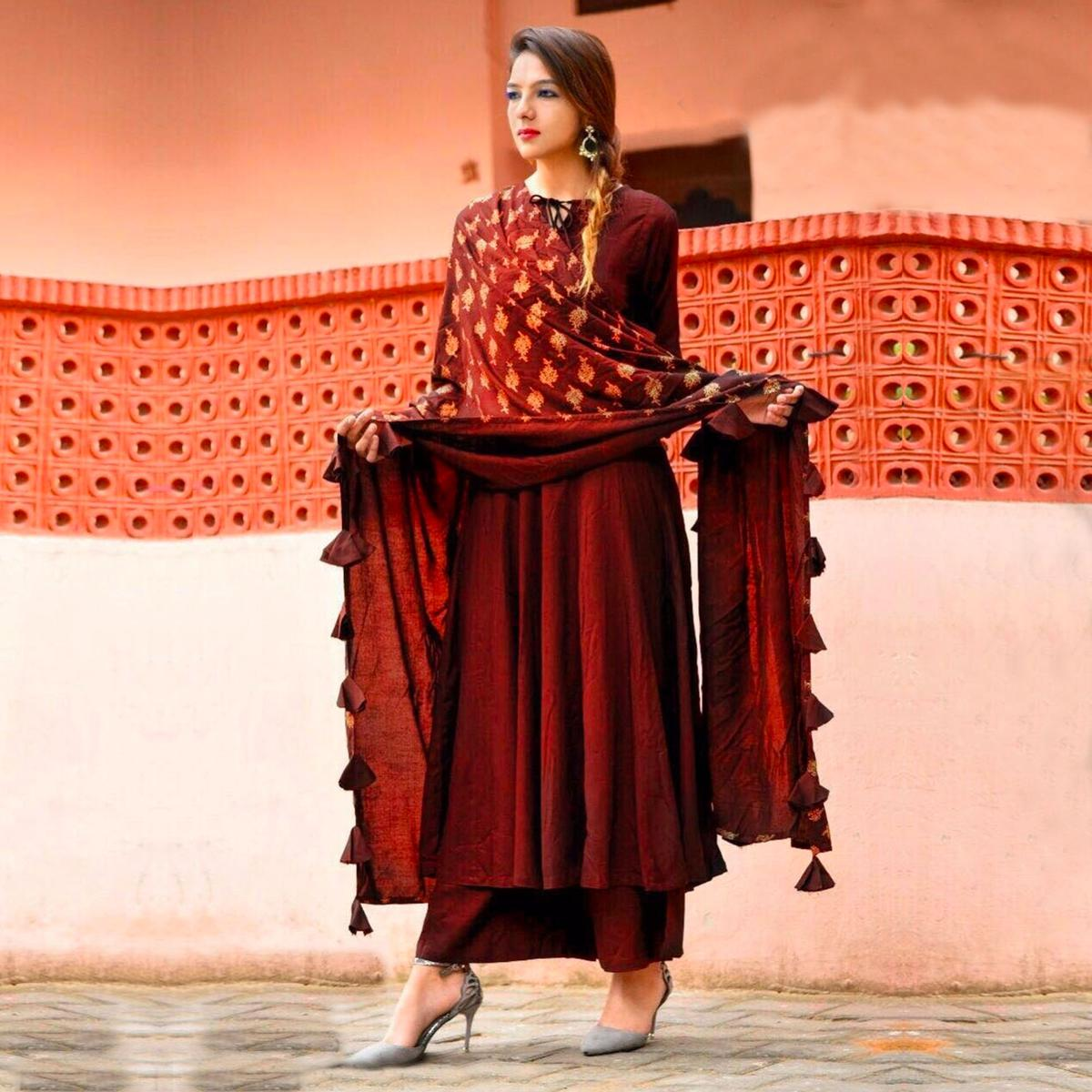 Capricious Maroon Colored Designer Partywear Rayon Kurti