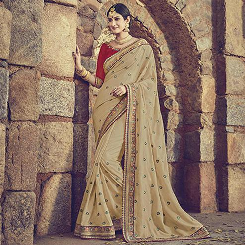 Staring Beige Colored Embroidered Partywear Cotton Silk Saree