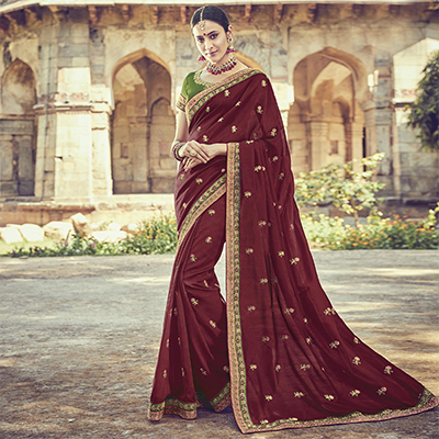 Gleaming Maroon Colored Embroidered Partywear Cotton Silk Saree