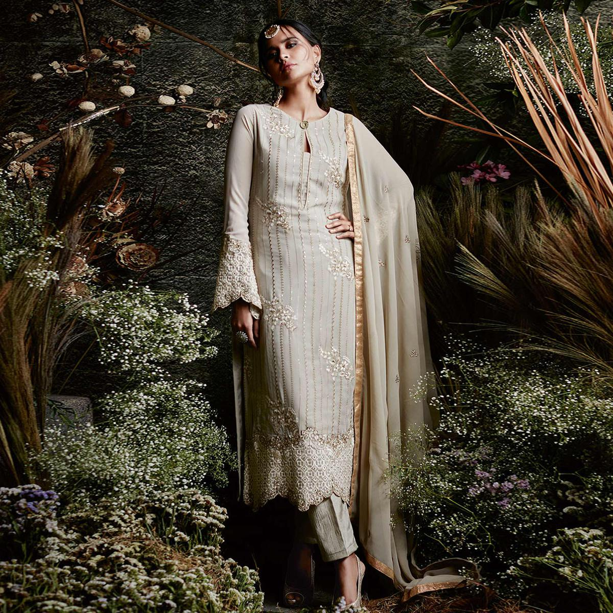 Impressive Beige Colored Partywear Embroidered Georgette Suit