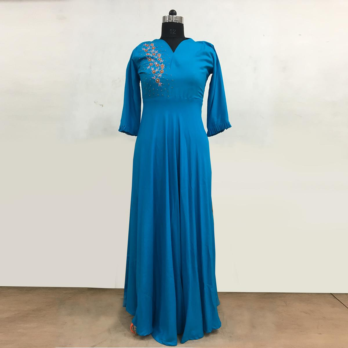 Glowing Blue Colored Partywear Embroidered Rayon Cotton Long Kurti