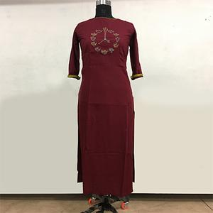 Pretty Maroon Colored Partywear Embroidered Rayon Cotton Long Kurti