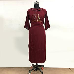 Refreshing Maroon Colored Partywear Embroidered Rayon Cotton Long Kurti