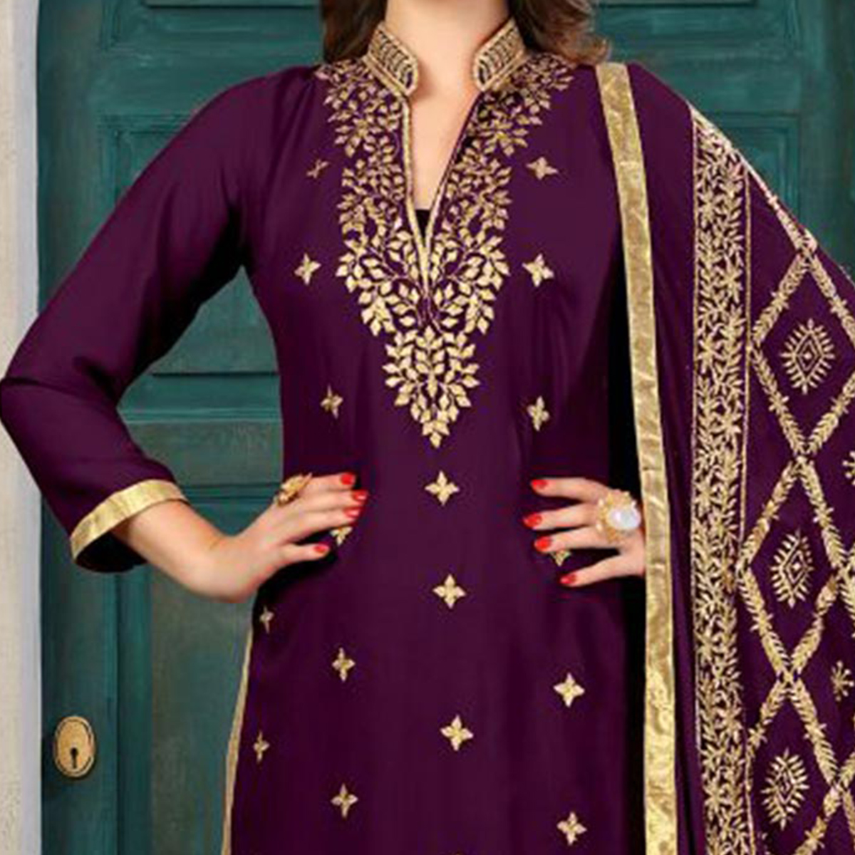 Amazing Purple Colored Partywear Embroidered Georgette Suit