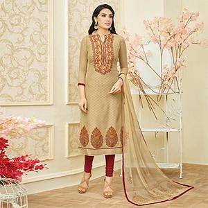 Gorgeous Beige Colored Partywear Embroidered Chanderi Silk Dress Material