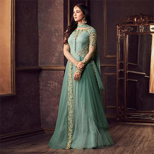 Attractive Aqua Green Colored Designer Partywear Heavy Embroidered Net Anarkali Suit
