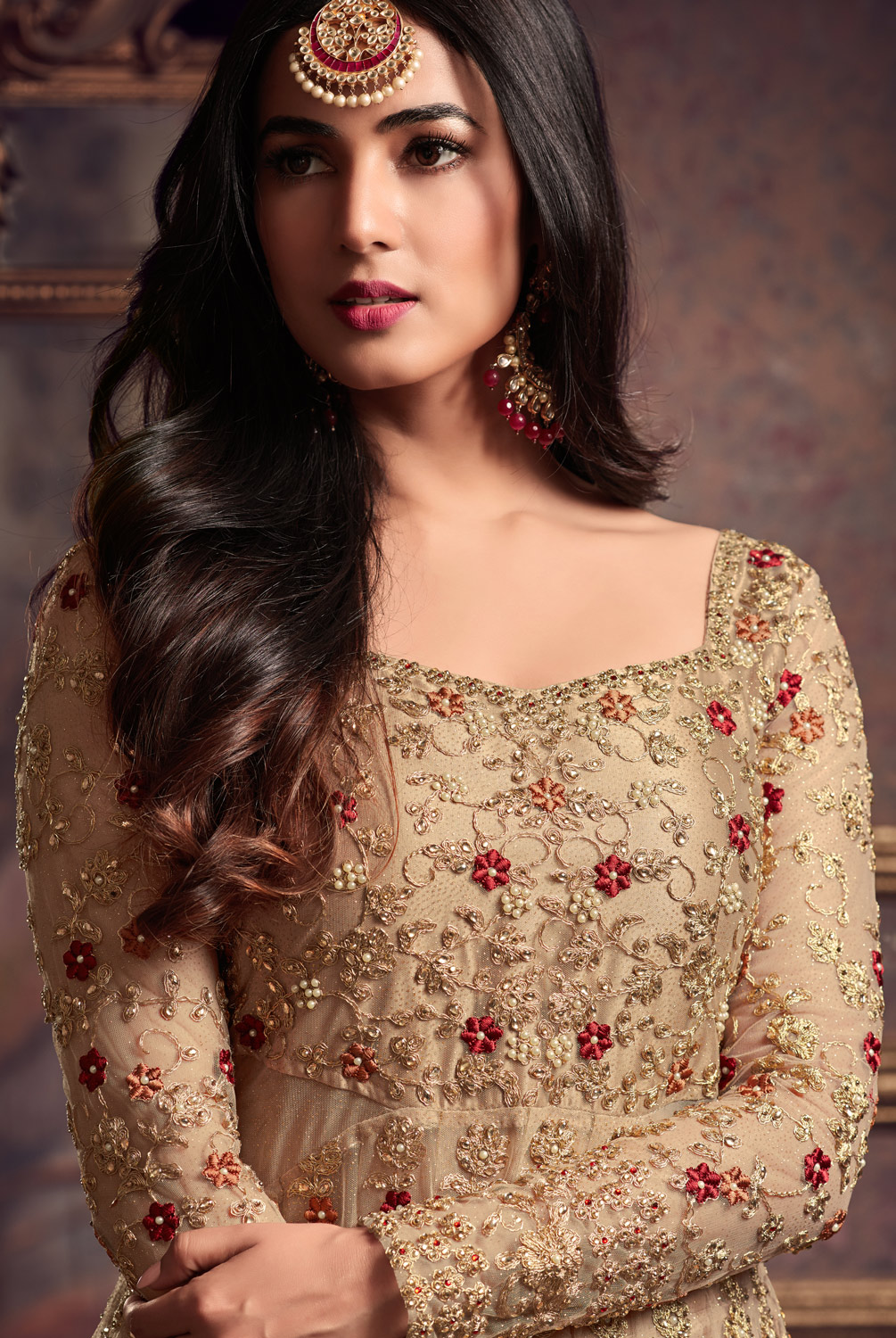 Refreshing Golden Colored Designer Partywear Heavy Embroidered Net Anarkali Suit