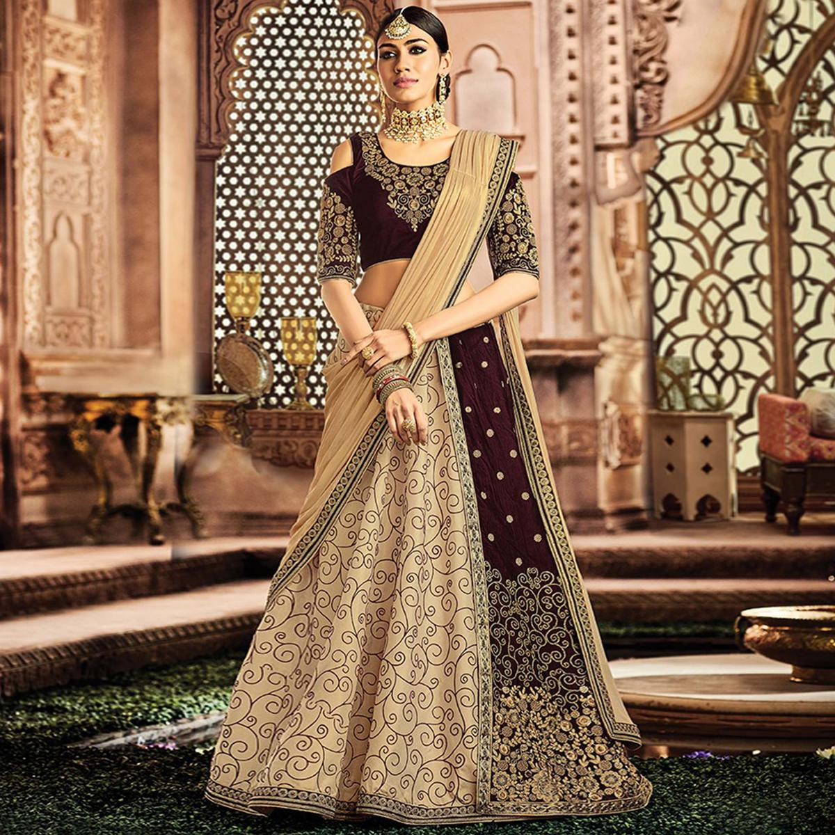 Opulent Cream-Brown Colored Designer Embroidered Wedding Wear Silk-Velvet Lehenga Saree