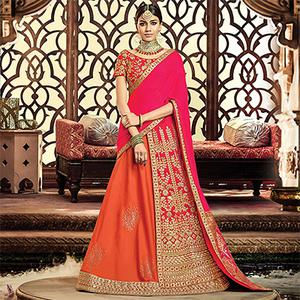 Unique Orange-Pink Colored Designer Embroidered Wedding Wear Tapeta-Raw Silk Lehenga Saree
