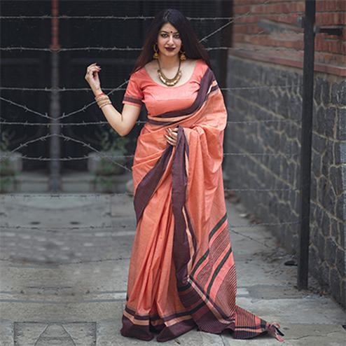 Mesmerising Peach Colored Festive Wear Raw Silk Saree
