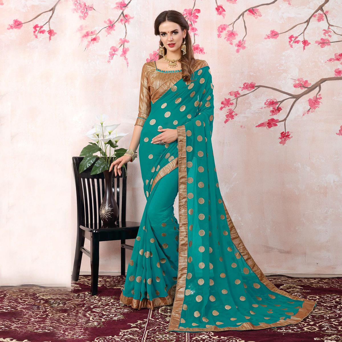 Demanding Turquoise Green Colored Casual Printed Georgette Saree
