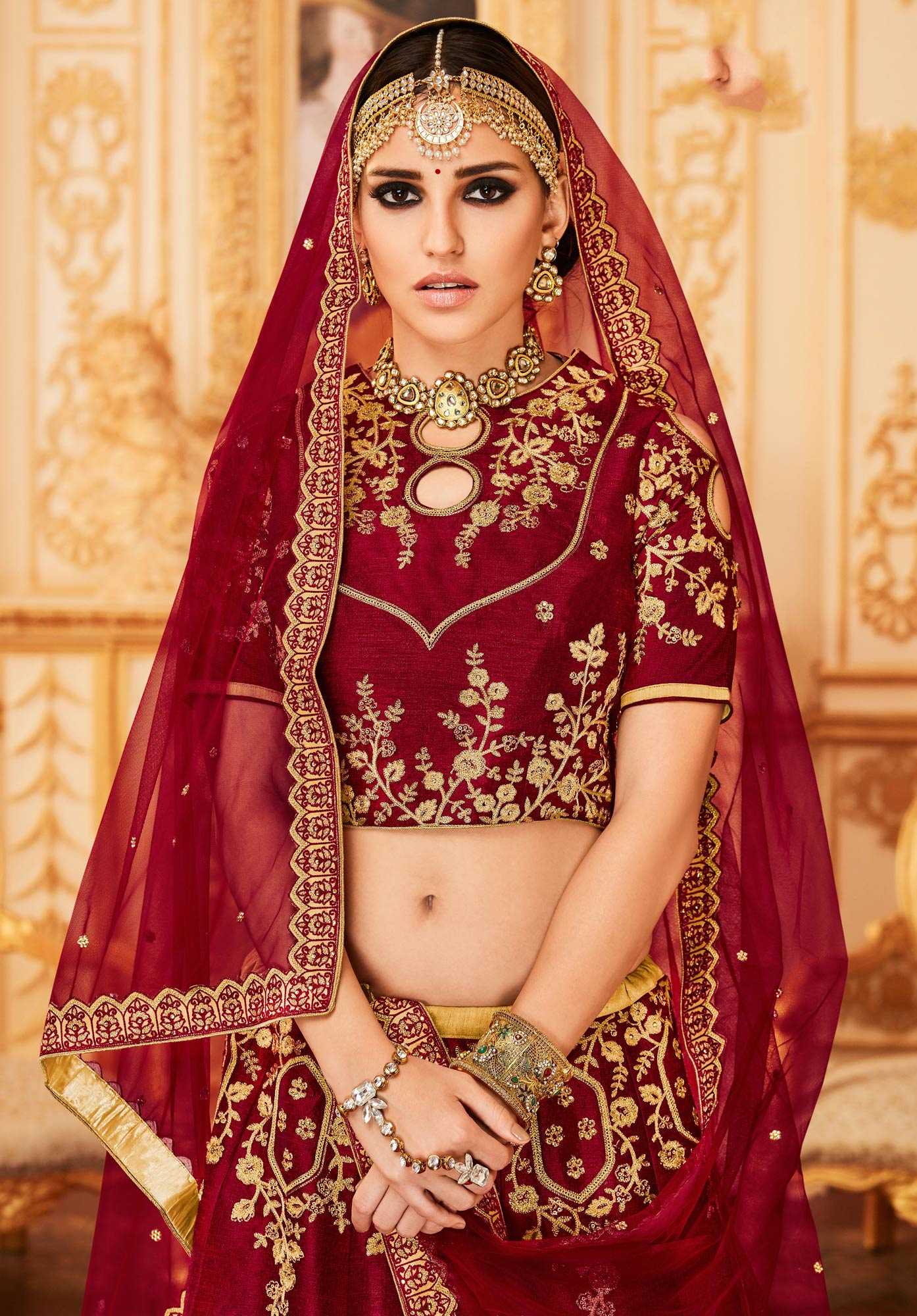 Maroon Colored Designer Embroidered Party Wear Raw Silk Lehenga Choli