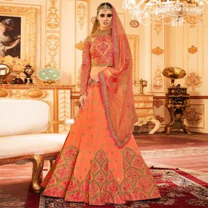 Orange Colored Designer Embroidered Party Wear Raw Silk Lehenga Choli