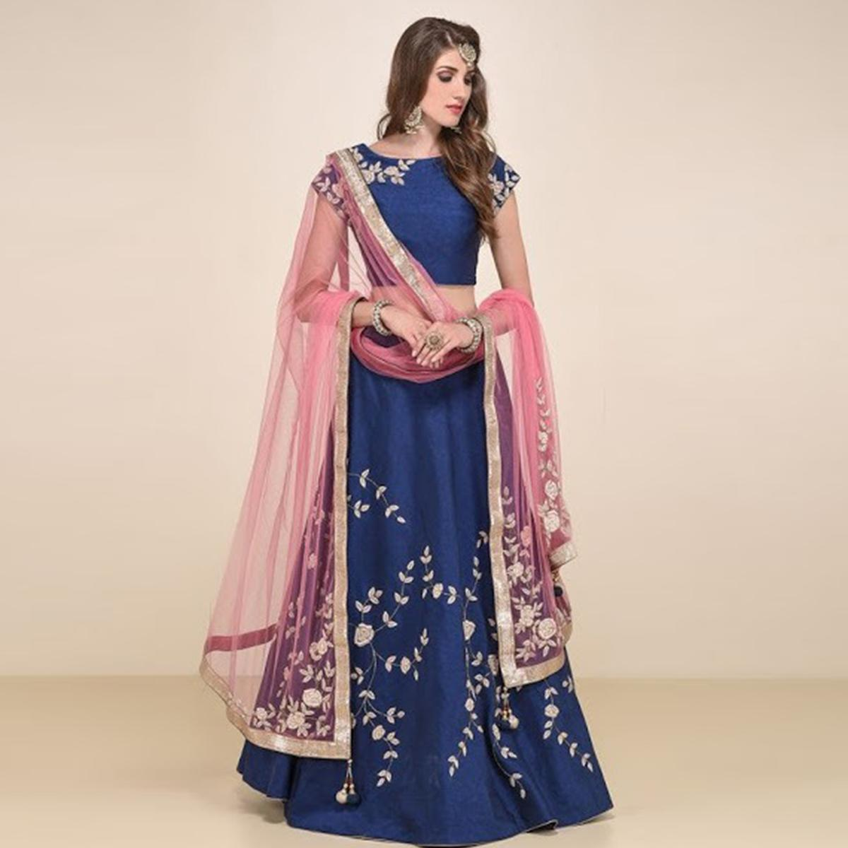 Intricate Navy Blue Colored Partywear Embroidered Tapeta Lehenga Choli