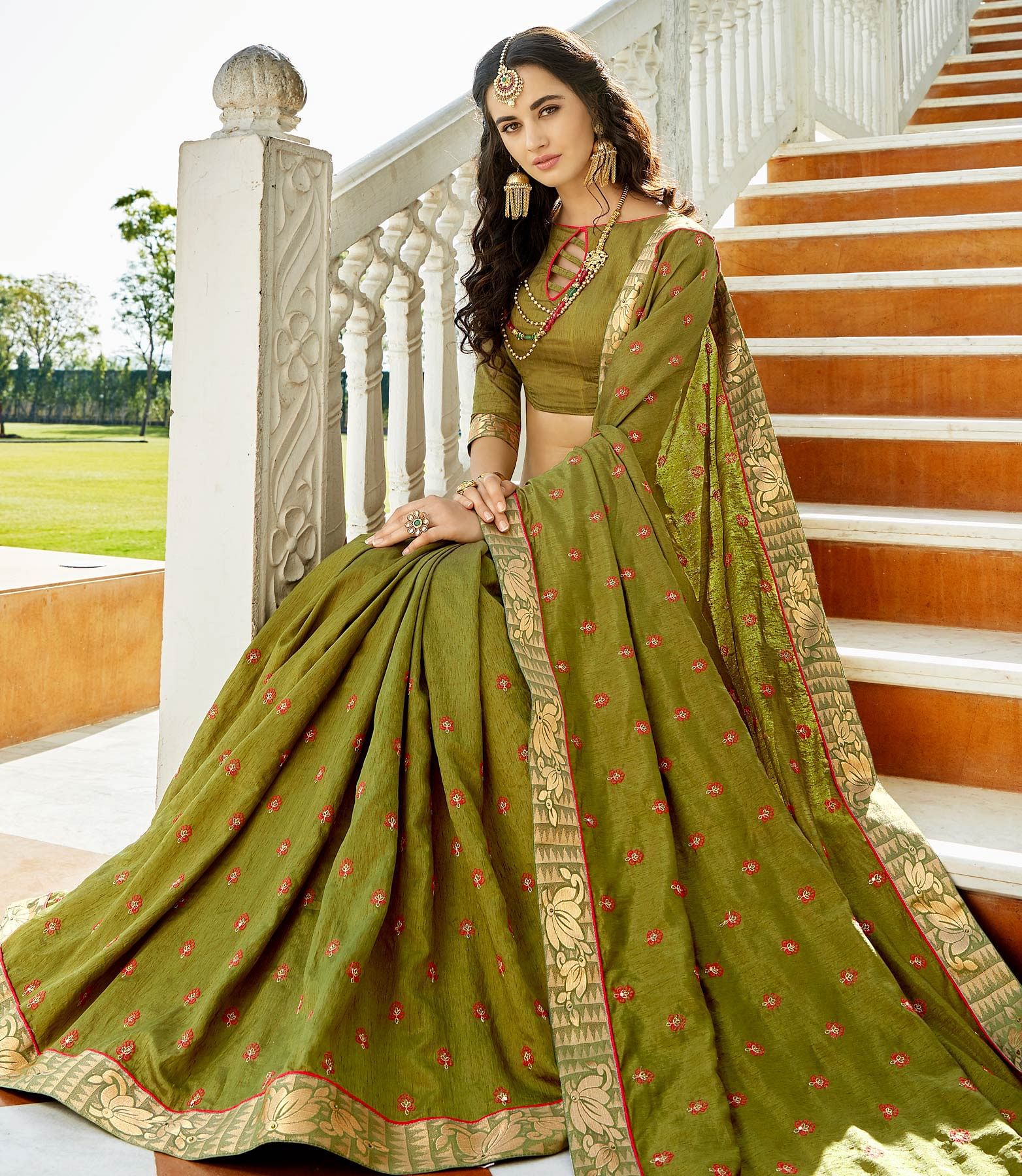 Desirable Olive Green Colored Designer Embroidered Soft Silk Saree