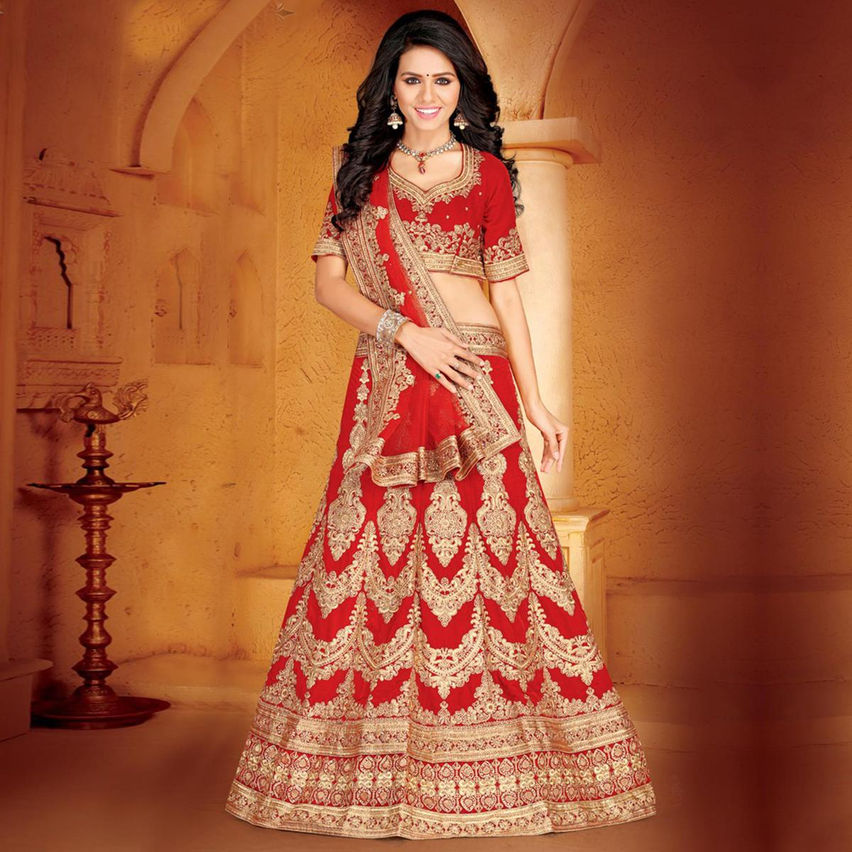 Radiant Red Colored Designer Embroidered Wedding Wear Velvet Lehenga Choli