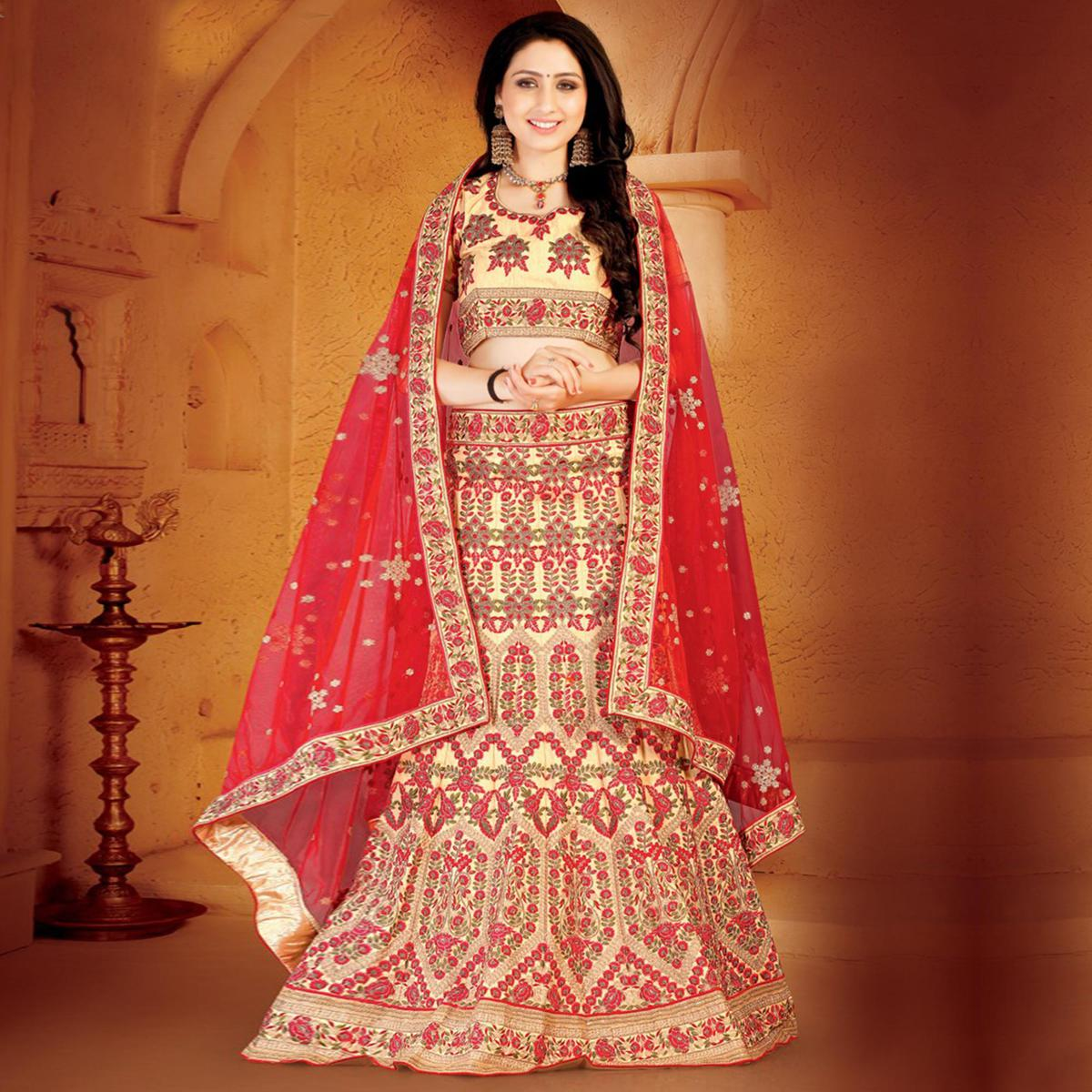 Desirable Cream-Red Colored Designer Embroidered Wedding Wear Linen Lehenga Choli