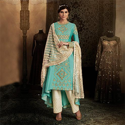 Demanding Firozi Colored Designer Embroidered Work Silk Suit