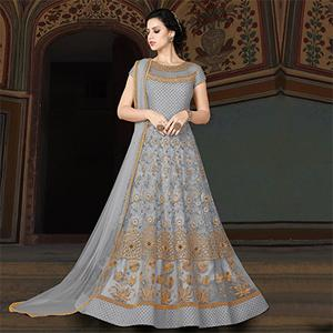 Lovely Gray Colored Partywear Embroidered Net Anarkali Suit