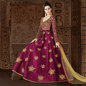 Dazzling Rani Pink Colored Partywear Embroidered Art Silk Anarkali Suit