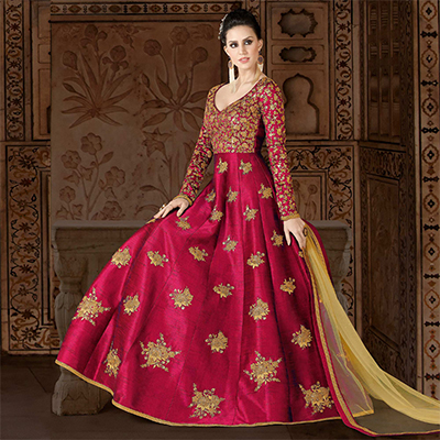 Attractive Fuschia Pink Colored Partywear Embroidered Art Silk Anarkali Suit