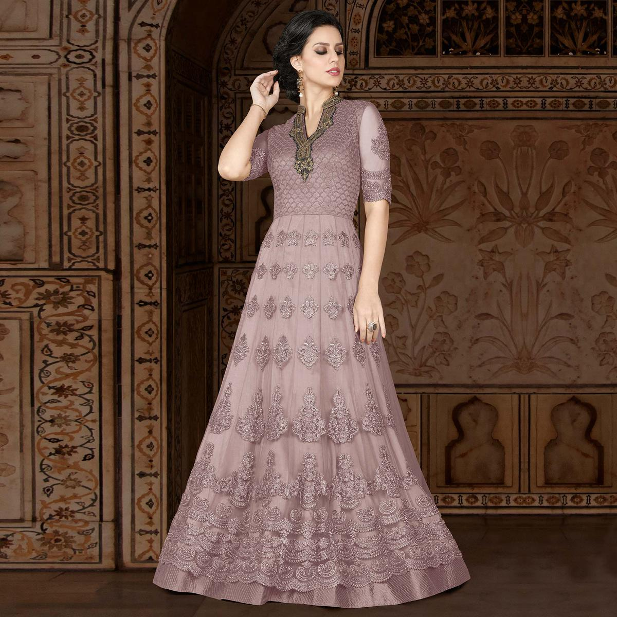 Eye-Catching Light Wine Colored Partywear Embroidered Net Anarkali Suit