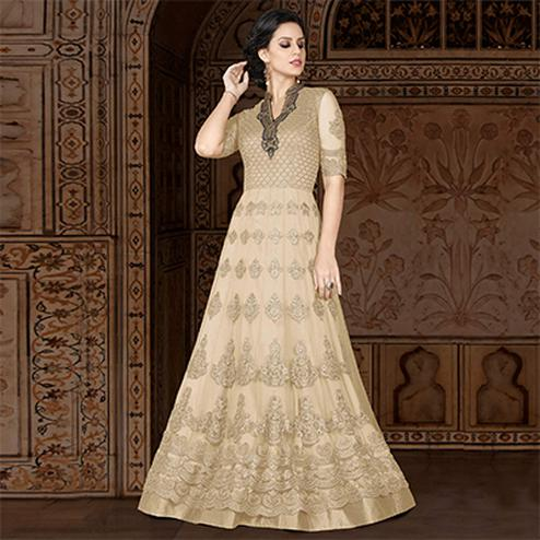 Gorgeous Beige Colored Partywear Embroidered Net Anarkali Suit