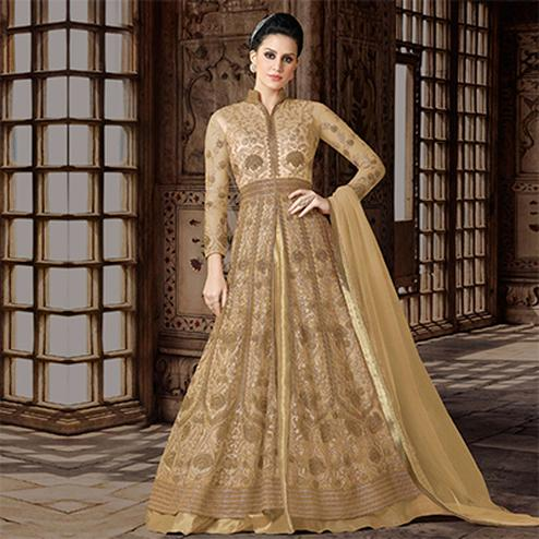 Mystic Beige Colored Partywear Embroidered Net Anarkali Suit