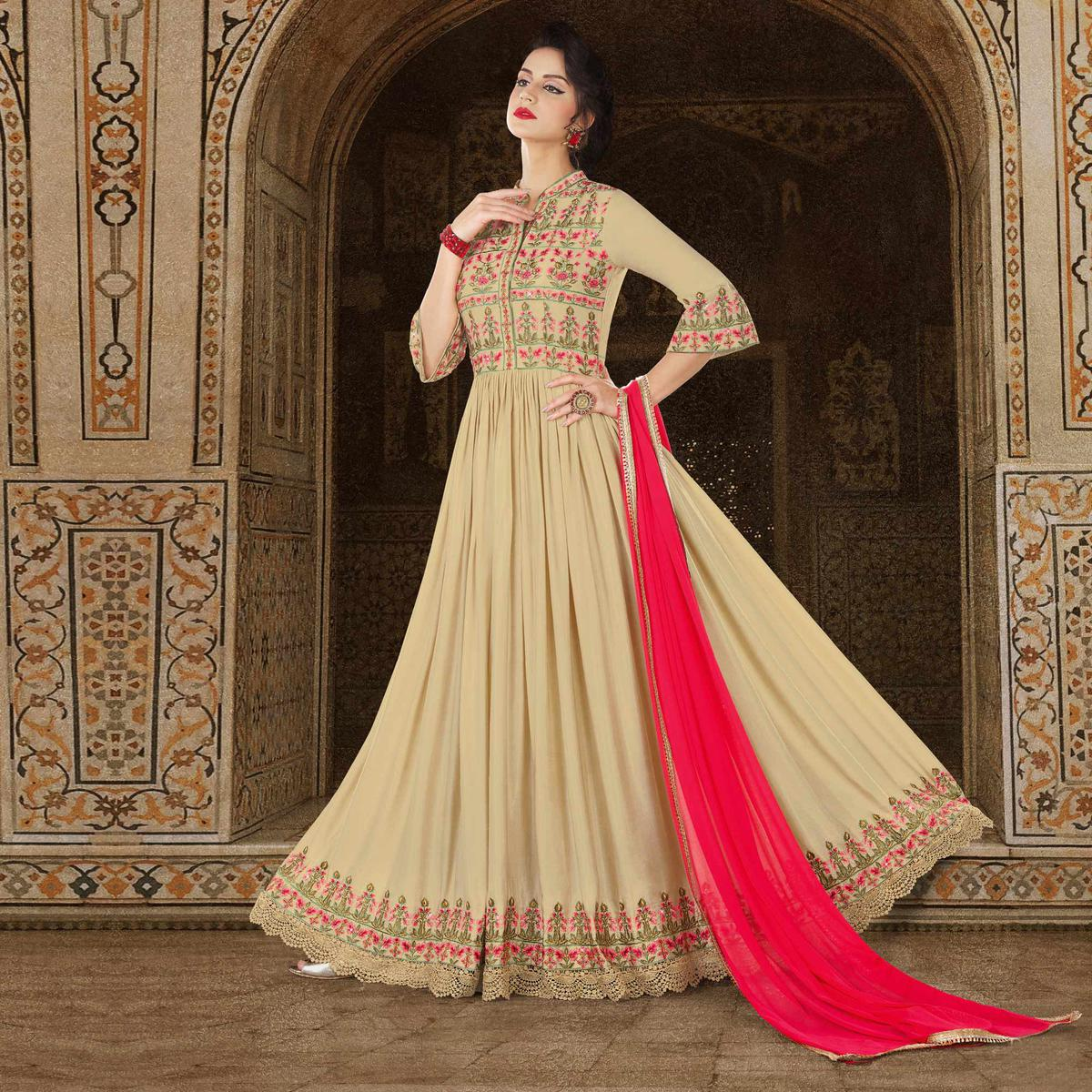 Dazzling Beige Colored Partywear Embroidered Satin Anarkali Suit