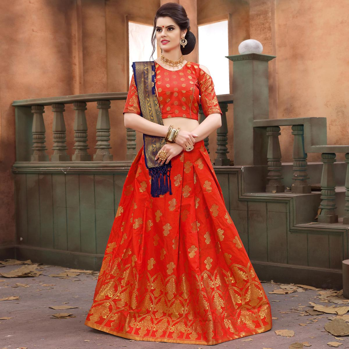 Majesty Orange Colored Festive Wear Embroidered Banarasi Silk Lehenga Choli