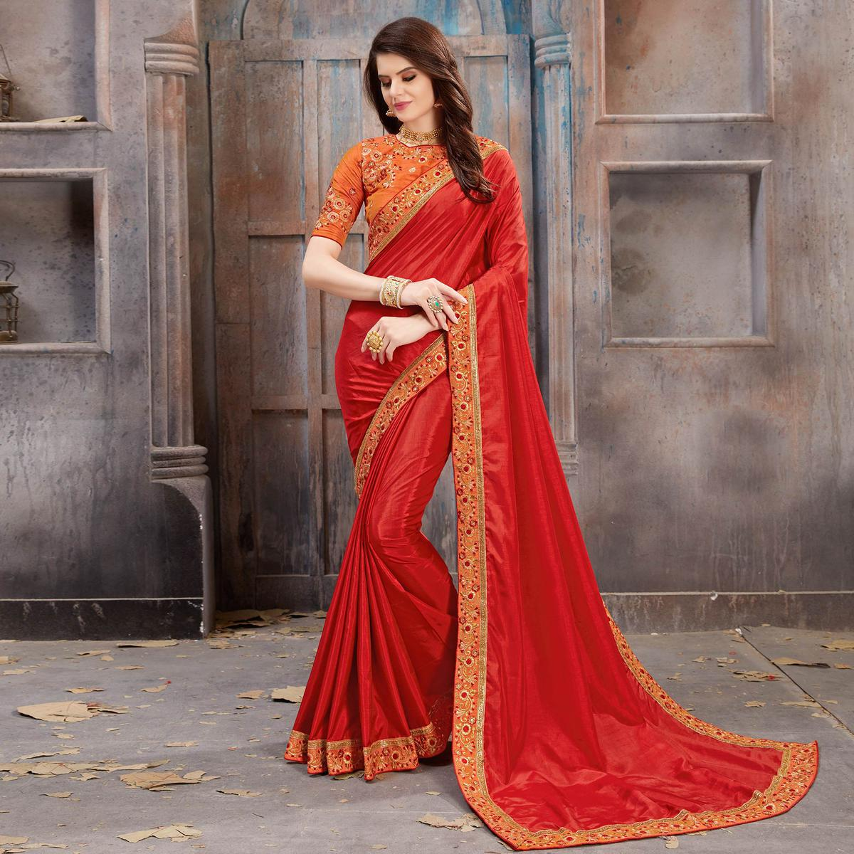 Beautiful Red Colored Partywear Embroidered Satin Silk Saree