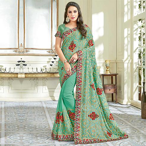 Pleasant Aqua Green Colored Designer Embroidered Work Party Wear Georgette Saree