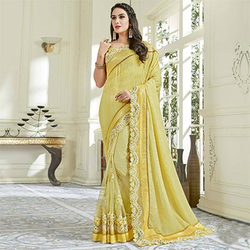 Unique Yellow Colored Designer Embroidered Work Party Wear Net Saree
