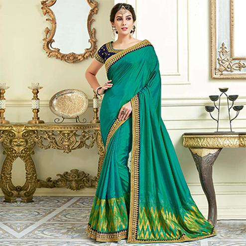 Refreshing Rama Green Colored Designer Embroidered Work Party Wear Dual Tone Silk Saree