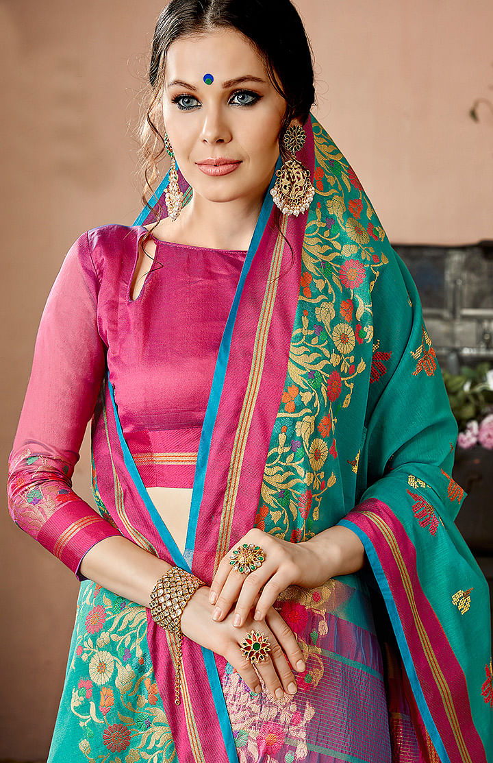 Charming Turquoise Blue Colored Embroidered Festive Wear Cotton Silk Saree