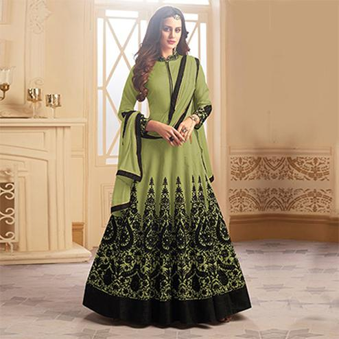 Stunning Green Colored Designer Embroidered C-N Tapeta Silk Anarkali Suit
