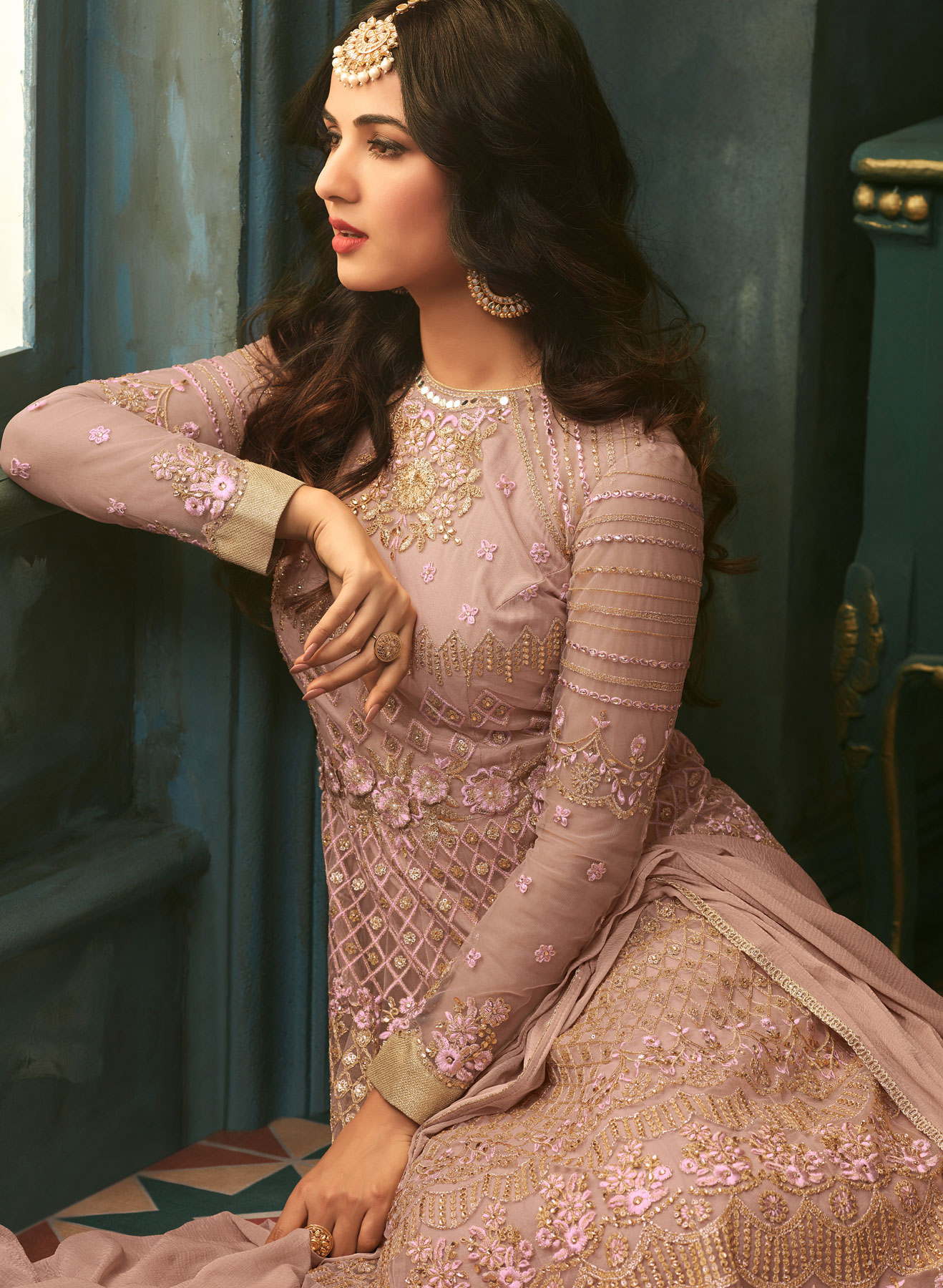 Capricious Rose Gold Designer Heavy Embroidered Work Wedding Wear Soft Net Anarkali Suit