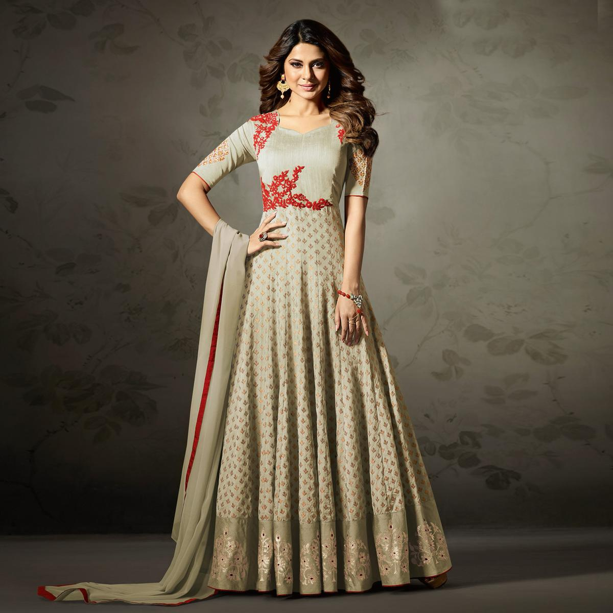 Stylish Cream Colored Partywear Embroidered Silk-Jacquard Anarkali Suit